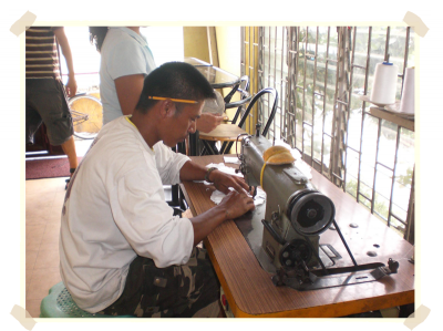 A participant of the Livelihood Project is sewing